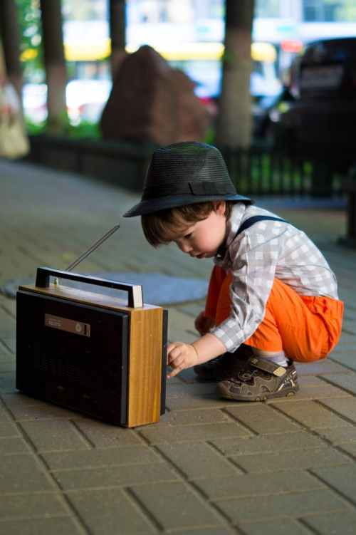 boy tuning transistor radio
